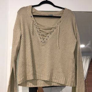 Cream Charlotte russe sweater with lace up neck